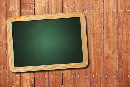 old blank blackboard on wood background photo