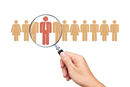 Find an employee with a magnifying glass Standard-Bild