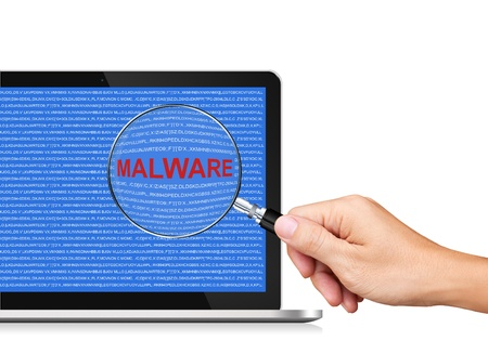malware: Searching Malware in Laptop Computer Stock Photo