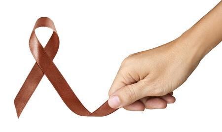 colon: Usata Marca nastro marrone per Colon Cancer simbolo su sfondo bianco Archivio Fotografico