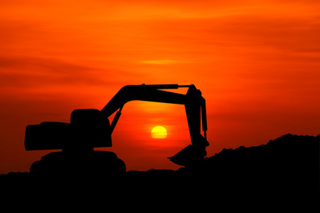 silhouette of excavator machine with sunset 版權商用圖片