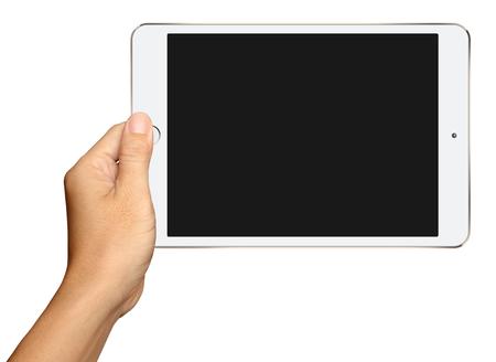 Hand hält kleine weiße Tablette-Computer auf weißem Hintergrund Standard-Bild