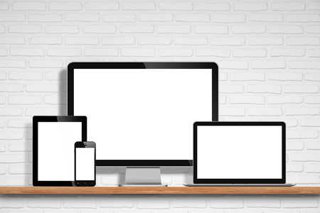 pc monitor: computer monitor, laptop, tablet pc and mobile phone with blank screen on the table with white brick wall background