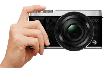 3D illustration interchangeable lens Mirrorless camera in hand isolated on white background Stok Fotoğraf