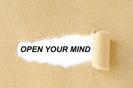 Open Your Mind appearing behind torn brown cardboard paper Stok Fotoğraf