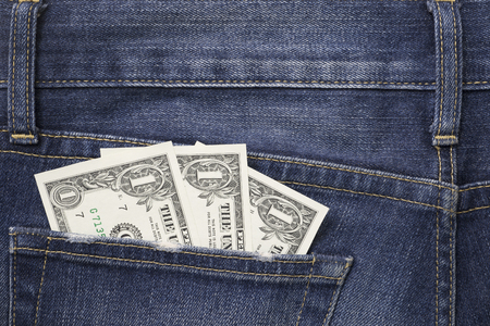Some dollars in a pocket of jeans