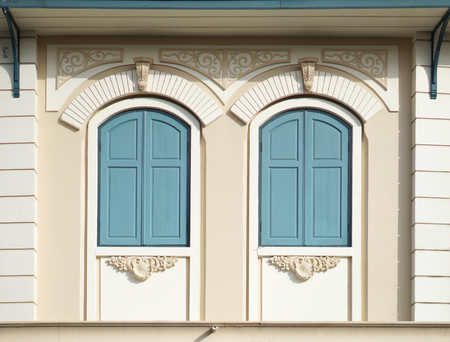 Blue painted wood arched windows in classic wall