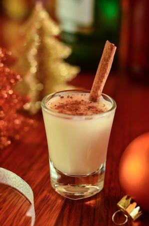 A glass of eggnog with Christmas stuff