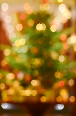 Bokeh of Christmas tree with golden decoration Stock Photo