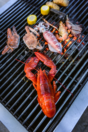 Lobster, crab, squid, prawn on charcoal grill