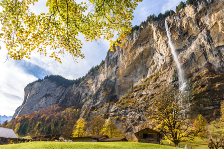 Beautiful autumn time at village of Lauterbrunnen in Swiss alps, gateway to famous Jungfrau. Set in a valley featuring rocky cliffs and the roaring, 300m-high Staubbach Falls