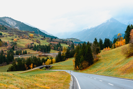 Road trip in Switzerland and enjoy beautiful landscape of mountain and countryside in Autumn