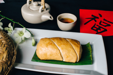 Concept picture for Chinese new year table set up and Chinese deish, bun with Chinese word means fortune Stockfoto