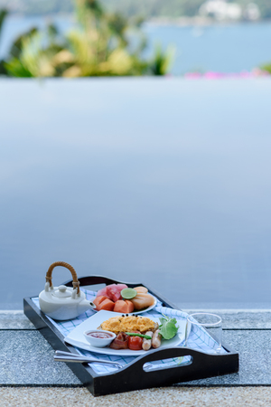 Breakfast tray by the swimming pool