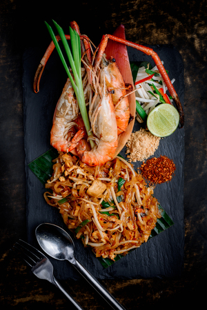 A beautiful presentation of Phad Thai with big river prawn on black stone