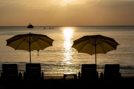 Luxury yellow beach umbrella and beach chair setup on Kamala beach, phuket, thailand Standard-Bild