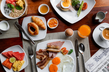 Setting of breakfast dishes in hotel restaurant
