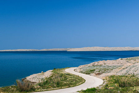 Concept picture of road trip in Croatia with scenic view by the sea at pag island in Croatia, Stockfoto
