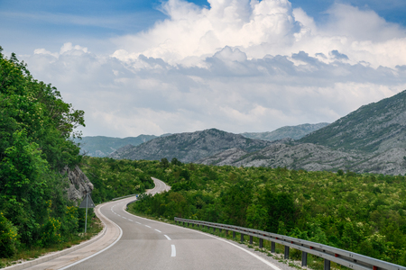 Concept picture of road trip in Montenegro, beautiful road pass through the greenery & stone mountain