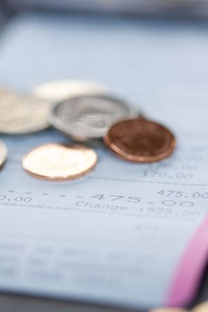 Restaurant bill and tip: selective focus photo