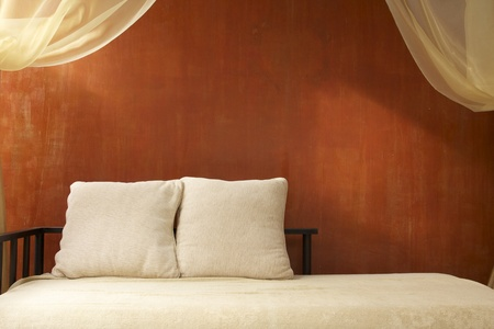 romantic bed and cushions photo