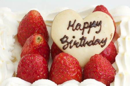 cake with icing: happy birthday strawberry fresh cream cake