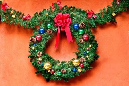 Christmas wreath on orange background with copyspace photo