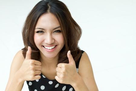 pulgar levantado: DOBLE dedo pulgar hacia arriba de las mujeres atractivas Foto de archivo
