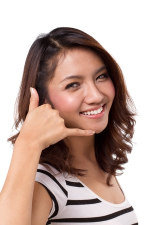 personal call: Call us contact us hand gesture of beautiful woman Stock Photo