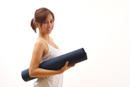 woman hand holding yoga mat for healthy fitness yoga workout photo