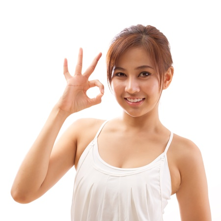 ok sign: woman hand posing ok hand sign for yoga or fitness workout