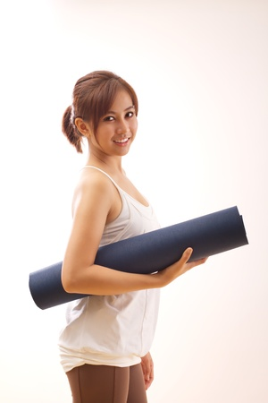 healthy woman hand holding yoga mat photo