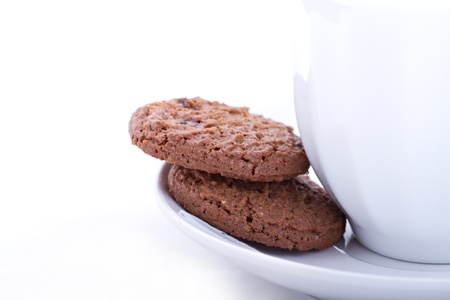 chocolate cookies with tea or coffee with partial isolated background for text Stock Photo