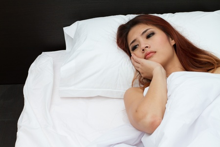 woman with insomnia in bedroom