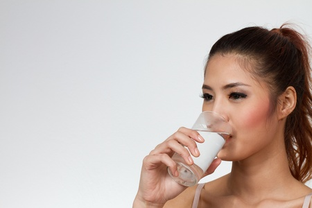 woman drinking water with text space or copyspace photo