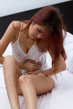 mild menstruation pain or stomach trouble photo