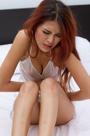 menstruation: serious menstruation pain or stomach trouble in bedroom