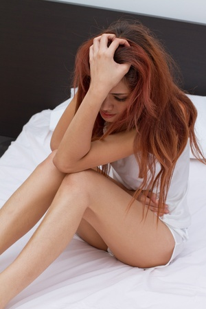 menstrual: woman with irritation caused by menstruation pain or stomach trouble