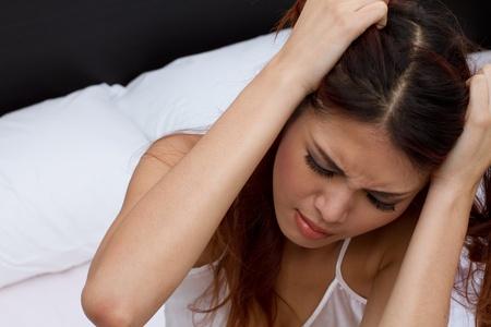 suffers: woman suffers from headache, migraine, emotional stress, insomnia or sleeplessness Stock Photo