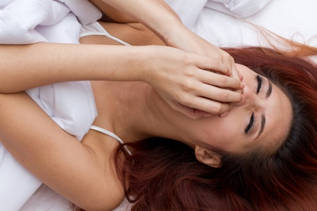 suffocate: woman on her bed, either choke or suffocate