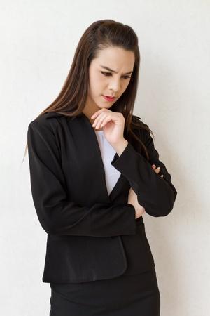female business executive thinking with stress or negative feeling photo