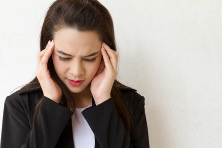 woman with headache, migraine, stress, insomnia, hangover in business executive dress photo