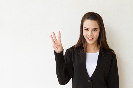 woman business executive showing 3 or three fingers hand gesture