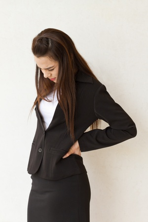 backpain of female business executive, concept of office syndrome with spinal or lower back problem photo