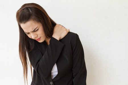 heavy shoulder pain or stiffness of female business executive, concept of danger office syndrome at serious stage