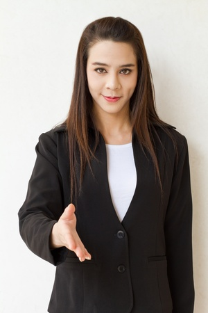 female business executive offering greeting with hand shake  photo