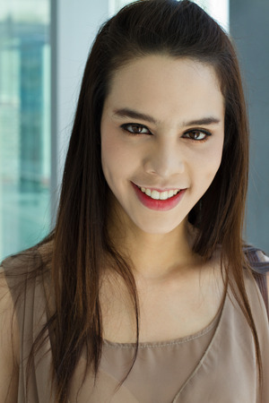 positive attitude: portrait of smiling beautiful female with positive attitude