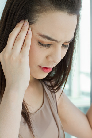 woman with headache, migraine, stress, hangover, mental problem   mild pain Stock Photo