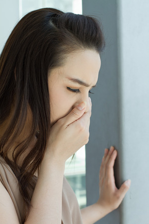 running nose: woman with cold or flu, running nose