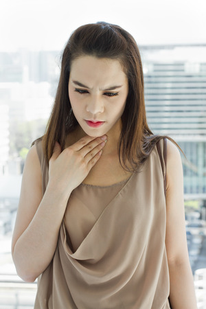 cold sore: sick woman with throat problem  Stock Photo